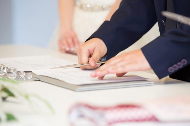Groom signing wedding license